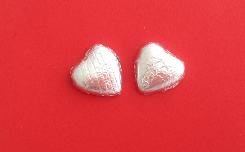 2 Silver Foil Covered Hearts Cracker Content