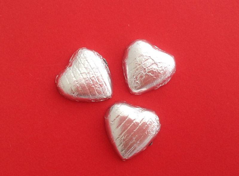 3 Silver Foil Covered Hearts Cracker Content